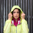 Serious female athlete wearing sport raincoat with hood — Stock Photo #59004333