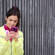 Female athlete texting message on smartphone — Stock Photo #59004527