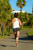 Female athlete running back view — Stockfoto