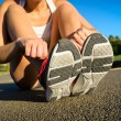 Female athlete getting ready for running — Stock Photo #60048939
