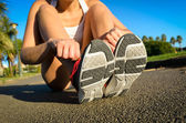 Female athlete getting ready for running — Stock Photo