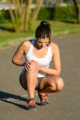 Female athlete suffering knee joint  sport injury — Stock Photo