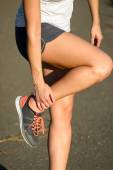 Female runner suffering ankle sprain sport  injury — Stock Photo