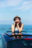 Happy woman on summer car vacation travel talking on cellphone — Stock Photo