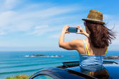 Woman taking photo with smartphone camera on summer travel — Stock Photo