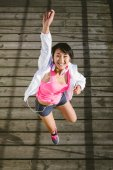 Sporty young happy woman jumping — Stock Photo