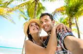 Couple on caribbean travel taking selfie photo — Stock Photo