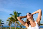 Joyful young woman on tropical caribbean travel — Stock Photo