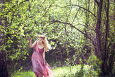 Girl in fairy dress walks in the woods — Stock Photo