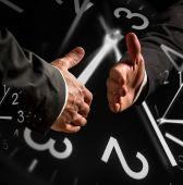 Business Handshake with Clock Overlays — Stock Photo
