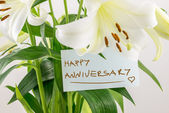 Happy anniversary floral gift — Stock Photo