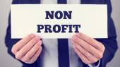 Businessman Holding Non Profit Signage — Stock Photo