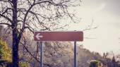 Blank signpost with left pointing arrow — Stock Photo