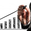 Businessman drawing an ascending bar graph — Stock Photo #57490969