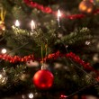Christmas tree decorated with lights and tinsel — Stock Photo #60601583