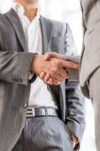 Businessman shaking hands with a client — Stock Photo