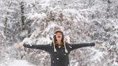 Happy vivacious woman celebrating the snow — Stock Photo