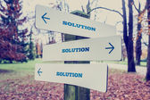 Signboard with the word Solution with arrows pointing in three d — Stock Photo
