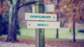Words Compliment and Insult in a conceptual image — Stock Photo