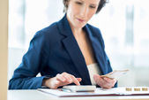 Young female bank officer at work — Stock Photo