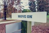 Move on concept with a rural signboard in an autumn landscape — Stock Photo
