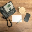 Top view of phone, blank paper, pen, coffee and a smart phone — Stock Photo #71885043
