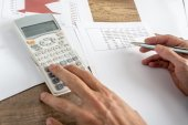 Closeup of male financial adviser calculating numbers — Stock Photo