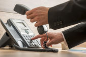 Communication operator dialing a telephone number — Stock Photo