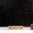 New Year 2016 background with falling snow and a red Christmas b — Stock Photo #83234082