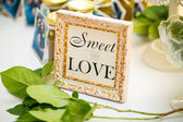 Sweet table. Frame with the message — Stock Photo