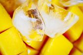Cut mango with ice — Stock Photo