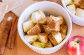 Red apples, cinnamon for apple pie — Stock Photo