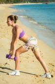 Beautiful fit female fitness model training and working out outs — Stock Photo