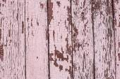 Old wooden planks painted with pink paint cracked by a rustic ba — Stock Photo
