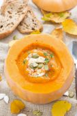 Spicy vegetable cream soup in a pumpkin and bread, top view — Stock Photo