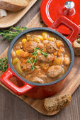 Delicious vegetable stew with sausages in a pan, top view — Stock Photo