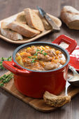 Delicious vegetable stew with sausages in a pan, vertical — Stock Photo