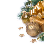 Composition with golden gift box and decorations, isolated — Stock Photo