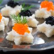Christmas appetizers with bread and caviar, close-up — Stock Photo #53501987
