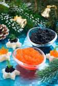 Christmas appetizers - red and black caviar, vertical — Stock Photo