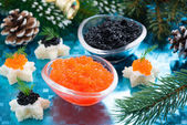 Christmas appetizers - red and black caviar — Stock Photo