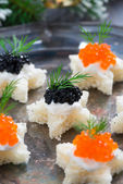 Christmas appetizers with bread and caviar, selective focus — Stock Photo