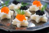 Christmas appetizers with bread and caviar, close-up — Stock Photo