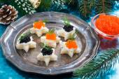 Christmas appetizers with caviar on a plate — Stock Photo