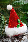 Christmas decoration in the form of hat in spruce branches — Stock Photo