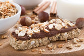 Oat bar with chocolate on wooden board, selective focus — Foto Stock