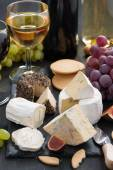 Delicacy soft cheeses, fruit and crackers - snacks for wine — Stock Photo