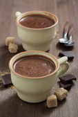 two cups of hot chocolate and sugar cubes — 图库照片