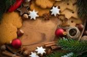 Wooden background with Christmas cookies and ingredients — Stock Photo