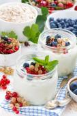 Yogurt with berries and products for healthy breakfast, top view — Foto Stock